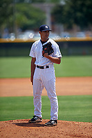 GCL Yankees West pitcher Alex Mejias (28) gets ready to deliver a pitch on the side field during the second game of a doubleheader against the GCL Yankees East on July 19, 2017 at the Yankees Minor League Complex in Tampa, Florida.  GCL Yankees West defeated the GCL Yankees East 3-1.  (Mike Janes/Four Seam Images)