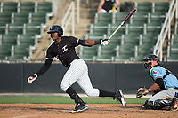 Micker Adolfo (27) of the Kannapolis Intimidators follows through on his swing against the Hickory Crawdads in game one of a double-header at Kannapolis Intimidators Stadium on May 19, 2017 in Kannapolis, North Carolina.  The Crawdads defeated the Intimidators 5-4.  (Brian Westerholt/Four Seam Images)