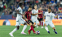 Foxborough, Massachusetts - April 13, 2019: First half action. In a Major League Soccer (MLS) match, New England Revolution (white) vs Atlanta United FC (red/black), at Gillette Stadium.
