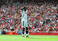 Pictured: Nathan Dyer of Swansea holds his head in disappointment having just missed the opportunity to score. Saturday 10 September 2011<br /> Re: Premiership Arsenal v Swansea City FC at the Emirates Stadium, London.