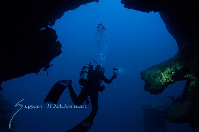 Diving through a cave