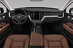 Stock photo of straight dashboard view of a 2018 Volvo XC60 T5 Momentum 4WD 5 Door SUV