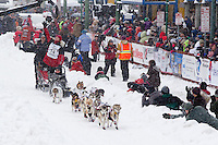 March 3, 2012 Aliy Zirikle waves to the crowd as she leaves down 4th avenue during the Ceremonial Start of Iditarod 2012 in Anchorage, Alaska.