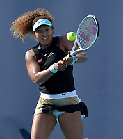 MIAMI GARDENS, FL - MARCH 29: (NO SALES TO NEW YORK POST) Naomi Osaka of Japan defeats Elise Mertens of Belgian on day 8 of the Miami Open on March 29, 2021 at Hard Rock Stadium in Miami Gardens, Florida<br /> <br /> <br /> People:  Naomi Osaka