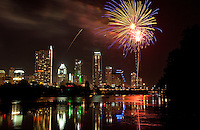 Colorful Fireworks light up the downtown skyline over Town Lake, Austin, Texas.