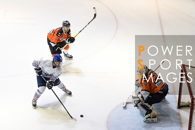 Liam Moorfield-Yee of HK Tigers (R) makes a save on Axel Benet of Flying French (L) during the Mega Ice Hockey 5s match between Hong Kong Tigers and Flying French on May 02, 2018 in Hong Kong, Hong Kong. Photo by Marcio Rodrigo Machado / Power Sport Images