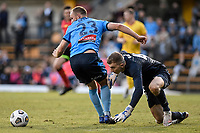 18th April 2021; Leichardt Oval, Sydney, New South Wales, Australia; A League Football, Sydney Football Club versus Adelaide United; Joe Gauci of Adelaide United mishandles the ball and has to retrieve it between the legs of Rhyan Grant of Sydney