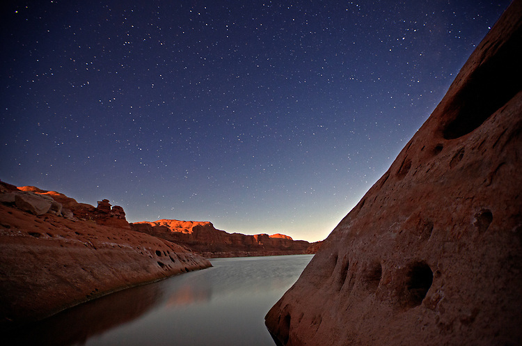 The full moon illuminates the sandstone cliffs near Cedar Canyon (mile 113) under a sky full of stars.  Viewed from our Day 3 camp on Lake Powell in the Glen Canyon National Recreation Area, Utah