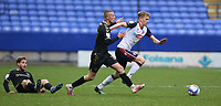 Bolton Wanderers' Harry Brockbank battles with Oldham Athletic's Conor McAleny (grounded) and Jordan Barnett<br /> <br /> Photographer Stephen White/CameraSport<br /> <br /> The EFL Sky Bet League Two - Bolton Wanderers v Oldham Athletic - Saturday 17th October 2020 - University of Bolton Stadium - Bolton<br /> <br /> World Copyright © 2020 CameraSport. All rights reserved. 43 Linden Ave. Countesthorpe. Leicester. England. LE8 5PG - Tel: +44 (0) 116 277 4147 - admin@camerasport.com - www.camerasport.com