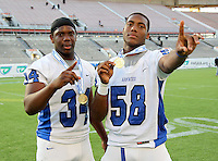 Armwood Hawks tight end Kyron Miles #34 and defensive lineman Byron Cowart #58 pose after the Florida High School Athletic Association 6A Championship Game at Florida's Citrus Bowl on December 17, 2011 in Orlando, Florida.  Armwood defeated Miami Central 40-31.  (Mike Janes/Four Seam Images)