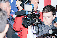 A videographer records as Texas senator and Republican presidential candidate Ted Cruz speaks to the media before a speech at The Village Trestle restaurant in Goffstown, New Hampshire, on Wed., Feb. 3, 2016.