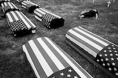 Washington DC<br /> USA<br /> September 24, 2005<br /> <br /> Anti-War, anti-Bush demonstration in DC attended by 100,000 from around the country.<br /> <br /> Coffins and crosses mark the Americans who have died during the war in Iraq.