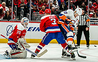 WASHINGTON, DC - JANUARY 31: Nick Jensen #3 of the Washington Capitals  and Anders Lee #27 of the New York Islanders clash in front of the Caps goal during a game between New York Islanders and Washington Capitals at Capital One Arena on January 31, 2020 in Washington, DC.
