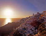 Greece; Cyclades; Santorini; Ia: beautiful sunsets as tourist attraction in the evening