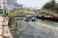 River Cruise Boat on the Melaka River, Pedestrian Bridge at Kampung Morten.  Melaka, Malaysia.