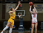 SIOUX FALLS, SD - MARCH 8: Chloe Lamb #22 of the South Dakota Coyotes shoots over Kadie Deaton #3 of the North Dakota State Bison during the Summit League Basketball Tournament at the Sanford Pentagon in Sioux Falls, SD. (Photo by Dave Eggen/Inertia)