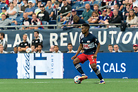 FOXBOROUGH, MA - AUGUST 18: Wilfrid Kaptoum #5 of New England Revolution dribbles during a game between D.C. United and New England Revolution at Gillette Stadium on August 18, 2021 in Foxborough, Massachusetts.