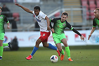 Chike Kandi of Dagenham and Adam Thomas of Stockport during Dagenham & Redbridge vs Stockport County, Vanarama National League Football at the Chigwell Construction Stadium on 8th February 2020