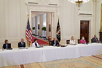 Ginni Rometty, CEO, IBM, second right, wears a mask as United States President Donald J. Trump delivers remarks at the American Workforce Policy Advisory Board Meeting at the White House in Washington, DC on Friday, June 26, 2020. <br /> Credit: Chris Kleponis / Pool via CNP/AdMedia