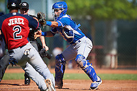 Kansas City Royals catcher Sebastian Rivero (2) catches a throw as Miguel Jerez (2) slides into home during an Instructional League game against the Cleveland Indians on October 11, 2016 at the Cleveland Indians Player Development Complex in Goodyear, Arizona.  (Mike Janes/Four Seam Images)