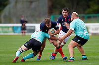 Kyle Whyte of London Scottish is tackled during the Championship Cup match between London Scottish Football Club and Nottingham Rugby at Richmond Athletic Ground, Richmond, United Kingdom on 28 September 2019. Photo by Carlton Myrie / PRiME Media Images