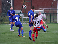 Essevee's Noa Delhaye (12) has an attempt on goal while Genk's Ine Reyners (7) tries to block during a female soccer game between the women teams of Zulte Waregem A Dames and KRC Genk Ladies B on the 1/16 th qualifying round for the Belgian Womens Cup 2020  2021 , on saturday 26 th of September 2020  in Zulte , Belgium . PHOTO SPORTPIX.BE | SPP | SEVIL OKTEM