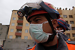 VAN, TURKEY: A rescue worker...On October 23, 2011, a 7.2 magnitude earthquake hit eastern Turkey killing over 250 people and wounding over a thousand...Photo by Ali Arkady/Metrography