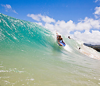Local youth bodyboarding at Pounders Beach on the east side of Oahu Hawaii, photographed from the water