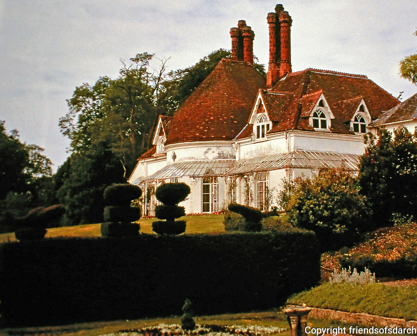Houghton Lodge with Peacock Garden.  A fishing lodge on the River Test in Hampshire, England which was built c.1800, possibly by John Nash.  Recently redesigned in Medieval fashion.