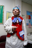 Richard J. Concepcion, a.k.a. Rapid T. Rabbit, waits in a dressing room before the start of the Kid's Expo parade in Poughkeepsie, New York.   Furries are a group of people who identify themselves not as being human but as a walking, talking animal.  For some the lifestyle is complete, animal traits reach into every aspect of life from mundane trips to a grocery store to sexual fantasies.  For others, involvement in the furry fandom is limited to public performances and meet-and-greets.