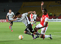 BOGOTA-COLOMBIA-22- ABRIL-2015. Yerry Mina (Der) jugador de Independiente Santa Fe de Colombia disputa el balon con  Martin Barragan  (Izq) jugador de Atlas de Mexico , durante partido por la segunda fase, llave G1, de la Copa Bridgeestone Libertadores 2015 jugado en el estadio Nemesio Camacho El Campin de la ciudad de Bogotá. / Yerry Mina(R) player of Independiente Santa Fe of Colombia fights for the ball with  Martin Barragan (L) player of Atlas of Mexico during the match for the second phase, G1 key, of the Copa Bridgestone Libertadores 2015 played at Nemesio Camacho El Campin stadium in Bogota city.Photo:VizzorImage / Felipe Caicedo / Staff