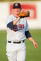 Logan Darnell #20 of the Elizabethton Twins warms up in the outfield prior to taking on the Greeneville Astros at Joe O'Brien Field August 15, 2010, in Elizabethton, Tennessee.  Photo by Brian Westerholt / Four Seam Images