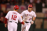 Los Angeles Angels outfielder Peter Bourjos #25 is greeted by third base coach Dino Ebel #12 after hitting a home run against the Baltimore Orioles at Angel Stadium on August 20, 2011 in Anaheim,California. Los Angeles defeated Baltimore 9-8.(Larry Goren/Four Seam Images)
