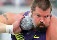 Nike's Christian Cantwell prepares to throw the shot in the men's shot put special at the Drake Relays on April 24, 2010 at Drake Stadium in Des Moines, Iowa.