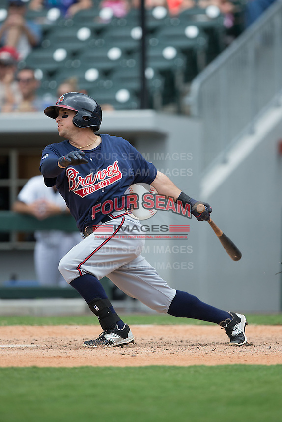 Sean Kazmar (9) of the Gwinnett Braves follows through on his swing against the Charlotte Knights at BB&T BallPark on July 3, 2015 in Charlotte, North Carolina.  The Braves defeated the Knights 11-4 in game one of a day-night double header.  (Brian Westerholt/Four Seam Images)