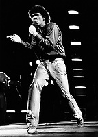 Montreal (Qc) CANADA - File Photo - circa 1983 - Robert Charlebois in concert.<br /> <br /> Photo by Denis Alix,