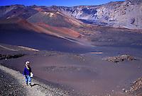 A small boy walks the moonlike multicolored Sliding Sands trail inside Haleakala Crater on the island of Maui.
