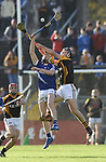 David Collins of Cratloe in action against Jack Browne of  Ballyea during the county senior hurling final at Cusack Park. Photograph by John Kelly.