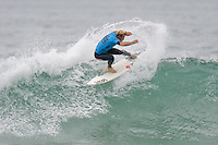 American Tanner Gudauskas with a tail slide during round of 48 at the 2010 US Open of Surfing in Huntington Beach, California on August 5, 2010.