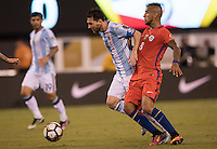 Action photo during the match Argentina vs Chile, Corresponding to Great Final of the America Centenary Cup 2016 at Metlife Stadium, East Rutherford, New Jersey.<br /> <br /> <br /> Foto de accion durante el partido Argentina vs Chile, correspondiente a la Gran Final de la Copa America Centenario 2016 en el  Metlife Stadium, East Rutherford, Nueva Jersey, en la foto: (i-d) Lionel Messi de Argentina  y Arturo Vidal de Chile <br /> <br /> <br /> 26/06/2016/MEXSPORT/David Leah.