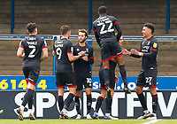 1st May 2021; Weston Homes Stadium, Peterborough, Cambridgeshire, England; English Football League One Football, Peterborough United versus Lincoln City; Lincoln City players celebrate Jorge Grant's penalty kick after 47 minutes (0-2)