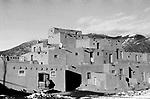Taos New Mexico pueblo adobe homes native American Indian elderly senior woman 1970s USA