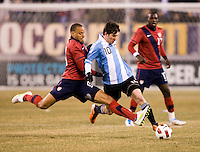 Jermaine Jones (13) of the United States fights for the ball with Lionel Messi (10) of Argentina during an international friendly at New Meadowlands Stadium in East Rutherford, NJ.  The United States tied Argentina, 1-1.