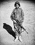 Private Ekram Din, of the Afghan National Army, is seen at the Regional Military Training Centre in helmand, 12 November 2012. This portrait was shot on a 5x4 Linhof Technika IV, circa 1959, and a Voigtlander Braunschweig Heliar 15cm lens, circa 1922. (John D McHugh)