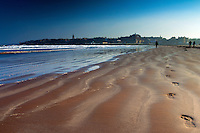 Footprints and walkers on West Sands, St Andrews, Fife