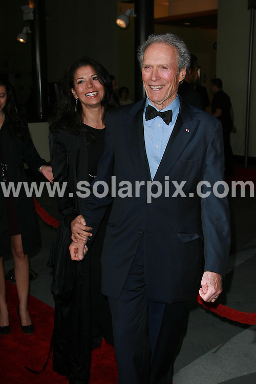 **ALL ROUND PICTURES FROM SOLARPIX.COM**                                             **SYNDICATION RIGHTS FOR UK, AUSTRALIA, DENMARK, PORTUGAL, S. AFRICA, SPAIN & DUBAI (U.A.E) & ASIA (EXCLUDING JAPAN) ONLY**                                                                                  Caption: 63rd Annual DGA Awards - Arrivals at The Grand Ballroom at Hollywood & Highland Center in Hollywood CA USA                                                                              This pic:  Clint Eastwood and wife Dina Eastwood                                                                                            JOB REF: 12729       PHZ       DATE: 29.01.2011                                                           **MUST CREDIT SOLARPIX.COM OR DOUBLE FEE WILL BE CHARGED**                                                                      **MUST AGREE FEE BEFORE ONLINE USAGE**                               **CALL US ON: +34 952 811 768 or LOW RATE FROM UK 0844 617 7637**