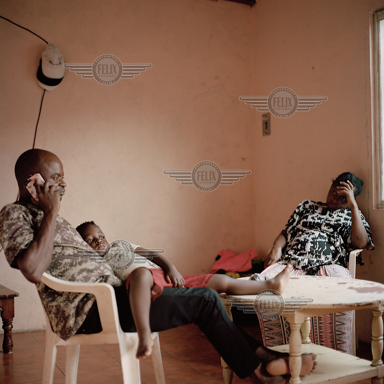 Paul Mananga (43), a migrant from Congo, with his wife Nacha and one of their three children in the small one-bedroom apartment they have rented in Tapachula. They say they left Congo due to political issues and lived in Argentina for about three years, leaving due to the racism they encountered. She recounts the crossing of the Darien Gap, a long stretch of jungle between Colombia and Panama, as the hardest part of their journey. During the crossing they were violently assaulted and, as a result, one of her children became traumatised. They've been in Mexico for four months, of which she spent 45 days in detention where she caught dengue fever. While the initial idea was to reach the US the family is now hoping to settle in Mexico City, once Mexican authorities allow them to leave Tapachula.