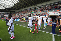 Pictured: Swansea players coming out of the tunnel. Saturday 23 August 2014<br /> Re: Premier League, Swansea City FC v Burnley at the Liberty Stadium, south Wales