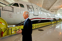 "Captain Chesley ""Sully"" Sullenberger was in Charlotte NC to greet the arrival of US Airways Flight 1549, also known as the Miracle on the Hudson plane, at the Carolina Aviation Museum in Charlotte, NC.  Two years earlier, the commercial passenger flight was enroute to Charlotte/Douglas International Airport when it was successfully landed in New York's Hudson River after striking a flock of Canada Geese six minutes after taking off from LaGuardia Airport."