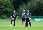 Manager Chris Coleman (right) watching Wales Football squad training at the Vale Resort near Cardiff today ahead of their trip to  Macedonia for Friday's World Cup qualifier.